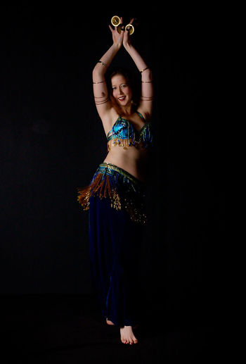 Belly Dance Belly Dancer Dance Beautiful Woman Belly Dancer Belly Dancing Bellydance Bellydancer Bellydancing Black Background Celebration Color Cultures Dancer Full Length Indoors  Looking At Camera One Person One Young Woman Only Performance Portrait Smiling Standing Young Adult Young Women