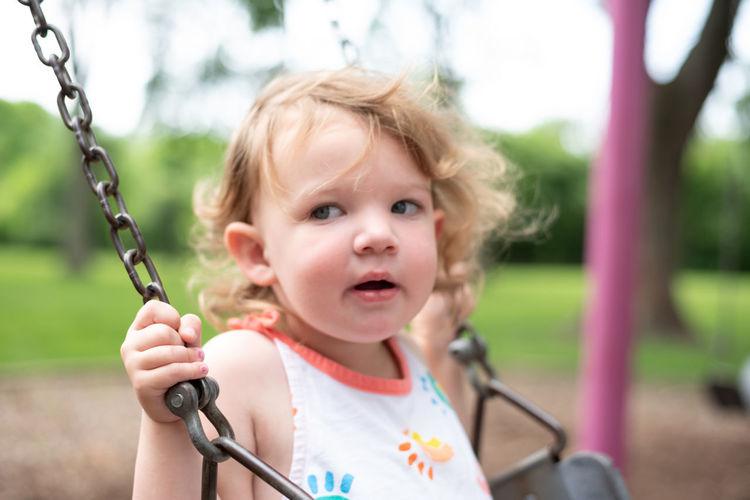 Portrait of cute girl holding swing