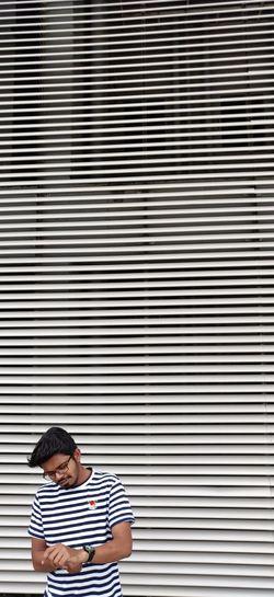 Man sitting on metal grate