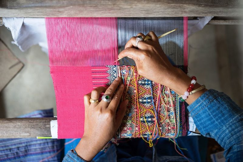 Cropped image of hand weaving on handloom