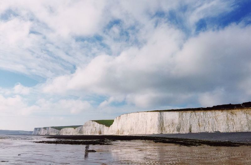 Seven Sisters Cliffs, South Downs. A view along the Seven Sisters Cliffs, East Sussex with Seaford Head in the distance. Beach British Copy Space Cliff Cloudscape Coastline Coastal Feature Day No People Freedom Lifestyles Seven Sisters Uk South Downs Hiking East Sussex Color Image Recreational Pursuit Outdoor Pursuit Horizon Over Water Beauty In Nature Horizon Space For Text Distant Sea