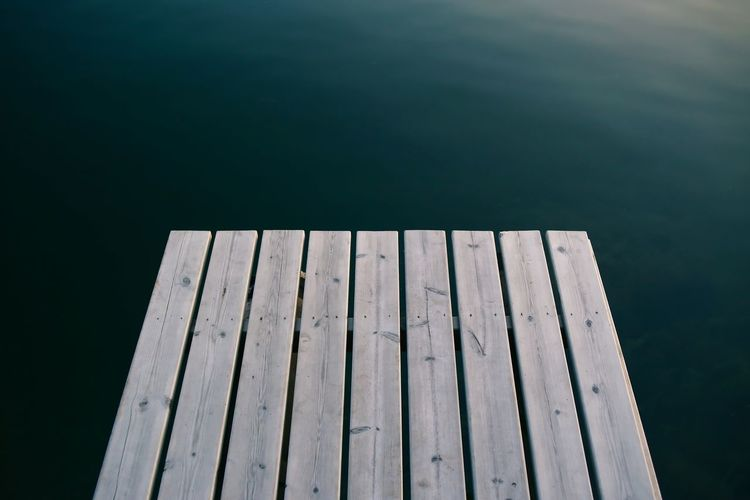 Wooden jetty over calm lake