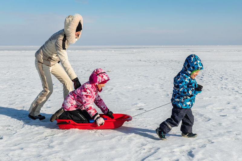 Full length of girl on snow covered land