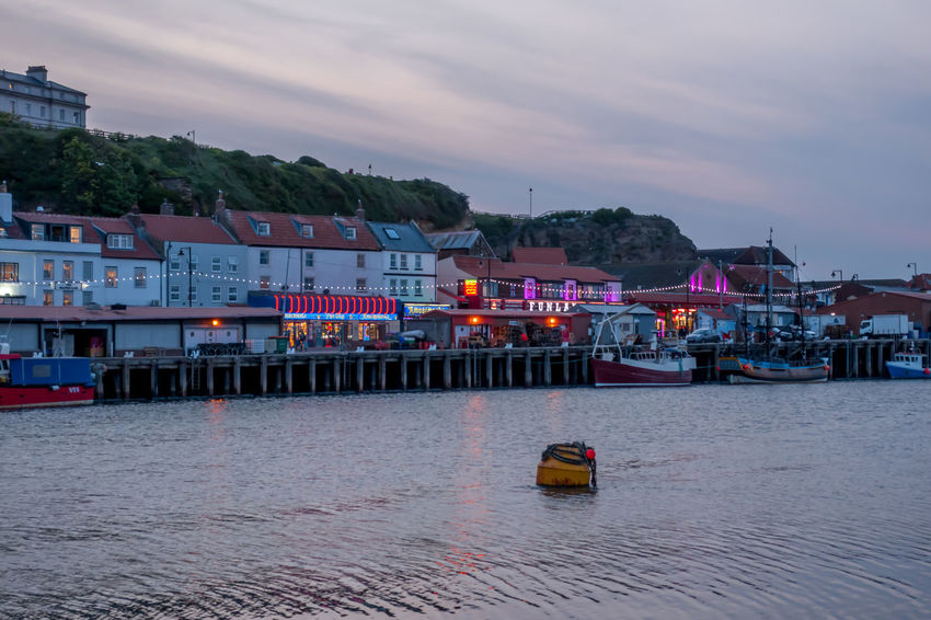 Whitby Whitby Harbour Whitby View Whitby North Yorkshire North Yorkshire North Yorkshire Coast Seaside Seaside Town Coastal Moored Sailboat Outdoors Sunset Ferry Cloud - Sky Dusk No People Passenger Craft Water Sky Nautical Vessel Waterfront River Sea Building