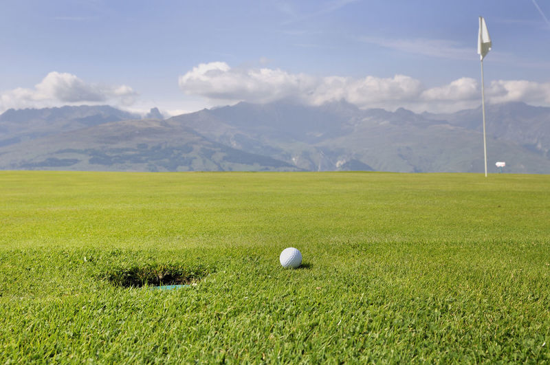 Ball Flag Golf Golf Course Grass Green - Golf Course Landscape Leisure Activity Mountain No People Scenics - Nature Sport