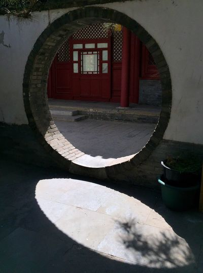 Circle is always regarded as perfect thing by Chinese culture. Can I get the perfect world through this circle door? Chinese Building Far Yuan Si Beijing Fine Art Photography