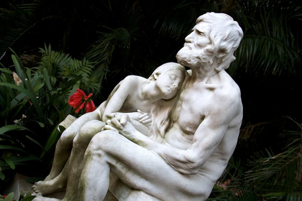 statue, sculpture, human representation, male likeness, art and craft, no people, outdoors, day, flower, close-up