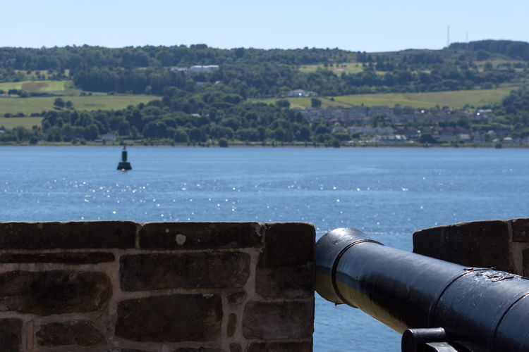 one of the cannons of Dumbarton Castle Water Nature Day Cannon Focus On Foreground Architecture Sea No People Sky Scenics - Nature Outdoors History Wall Weapon Beauty In Nature The Past Tree Plant Stone Wall Historic