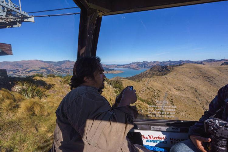 Man on landscape against mountain range