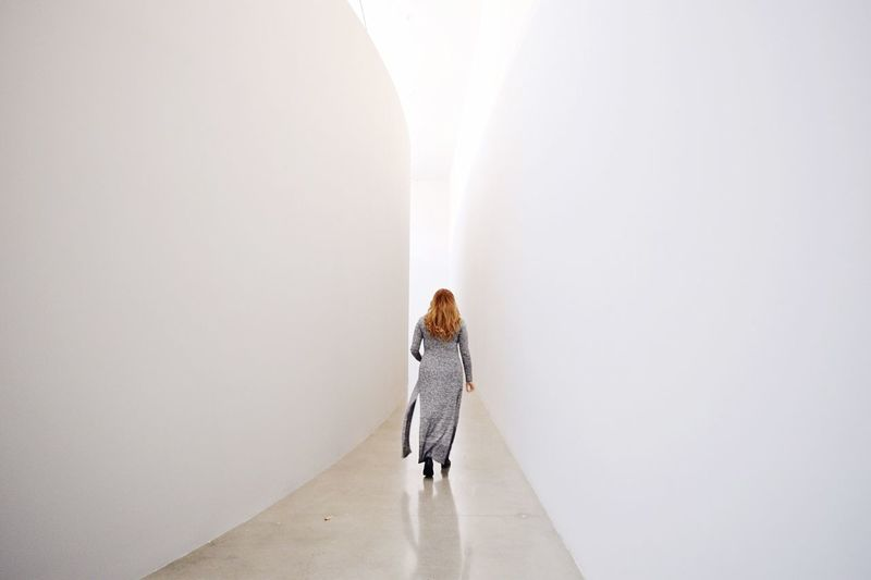 Full length of woman standing in the dark