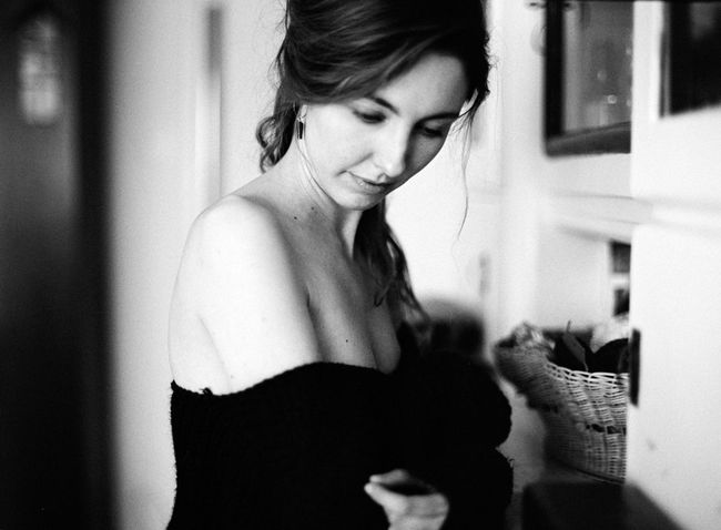 Adult Analog Beautiful Woman Blackandwhite Casual Clothing Focus On Foreground Hairstyle Happiness Home Interior Indoors  Leisure Activity Lifestyles Mediumformat One Person Real People Side View Smiling Standing Three Quarter Length Waist Up Women Young Adult Young Women