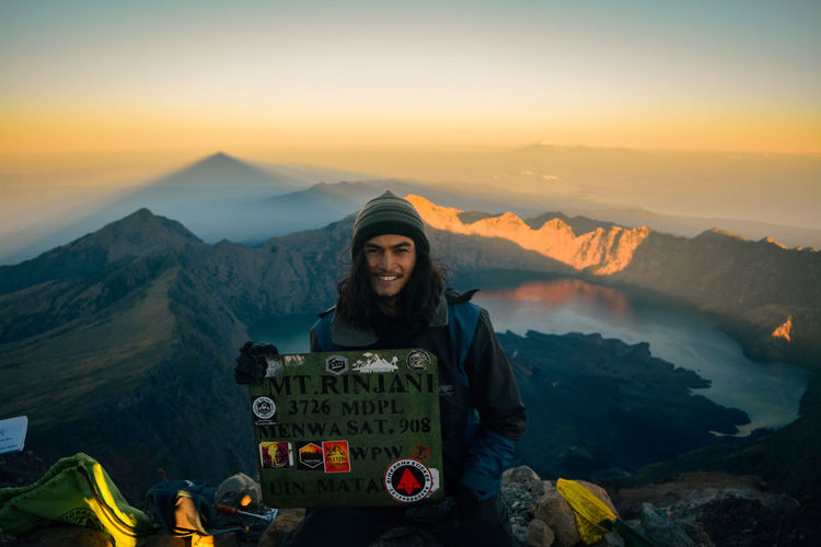 Top Of Rinjani Peak, 3726 Masl, National Park Beauty In Nature Beauty In Nature Front View Leisure Activity Lifestyles Looking At Camera Model Mountain Mountain Range Nature Non-urban Scene One Person Outdoors Peak Portrait Real People Scenics - Nature Sky Smiling Standing Sunset Text Young Adult Young Women
