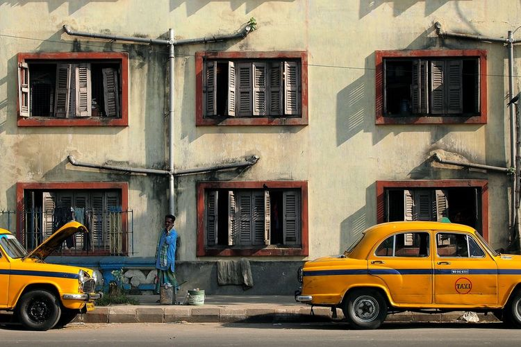 When we were looking at each other. Architecture Calcutta India Kolkata Land Vehicle Mode Of Transport Parking People Looking At Me Residential Building Shadow Taxi Themoment Window Yellow Meinautomoment