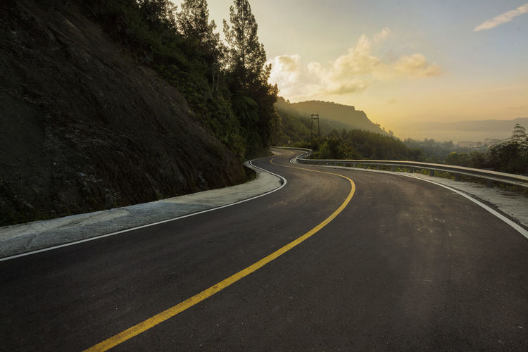 Winding road around samosir island overlooking breathtaking views of lake toba.