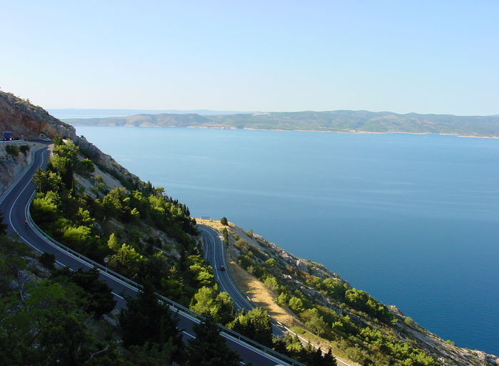 makarsca rivera croatia Croatia Serpentine Architecture Beauty In Nature Built Structure City Clear Sky Day High Angle View Mountain Nature No People Outdoors Plant Scenics - Nature Sea Serpentine Sky Tranquil Scene Tranquility Transportation Tree Water Coastline Aerial View Rocky Coastline