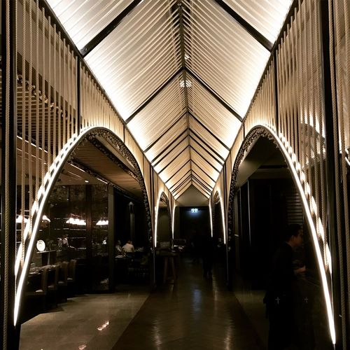 Architecture Indoors  Built Structure Ceiling Illuminated Direction Transportation The Way Forward Incidental People Mode Of Transportation Building Public Transportation Architectural Column Pattern Men Arch Lighting Equipment Day Real People Diminishing Perspective