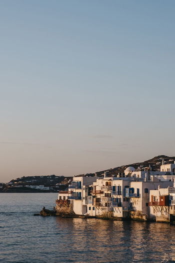 Sunset over the old houses in little venice, mykonos, greece.