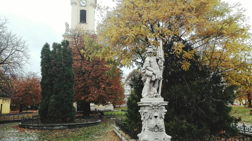 Tree Statue Human Representation No People Fountain Sculpture Sky Nature Outdoors Water Sprinkling Day Church Church Buildings Budapest, Hungary Budapest Beauty In Nature Tree Autumn Colors Autumn Leaves
