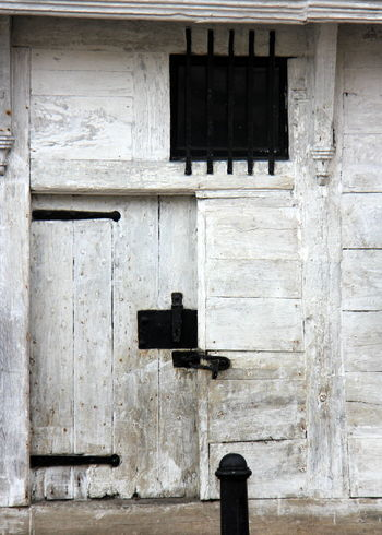 Architecture Bars Black Building Exterior Built Structure Day Door Iron Mongery Medieval No People Outdoors Town Hall White Wood - Material