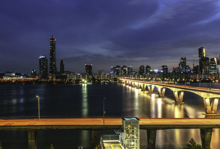 Architecture Bridge Bridge - Man Made Structure Building Building Exterior Built Structure City Cityscape Connection Financial District  Illuminated Modern Nature Night No People Office Building Exterior Outdoors River Sky Skyscraper Tall - High Urban Skyline Water