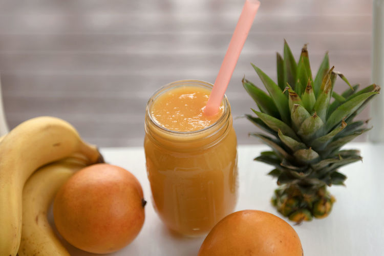 Mango Smoothie Banana Close-up Day Drink Drinking Glass Drinking Straw Food Food And Drink Freshness Fruit Healthy Eating Healthy Lifestyle Indoors  No People Refreshment Smoothie Table