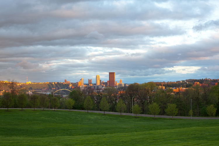 Schenley Park at Oakland neighborhood and downtown city skyline, Pittsburgh, Pennsylvania, USA Downtown Pennsylvania Pittsburgh Schenley Park Architecture Building Exterior Built Structure Central Business District City Cityscape Cloud - Sky Dawn Grass Green Color Landscape Nature No People Outdoors Sky Skyscraper Sunrise Sunset Travel Destinations Tree Urban Skyline