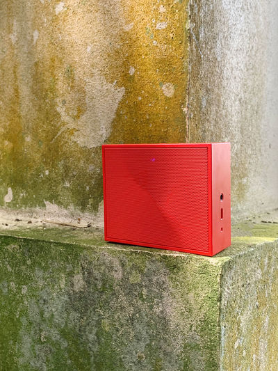 Close-up of red box on wall