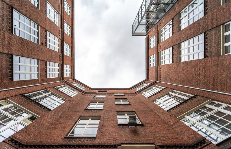 Directly Below Office Building Exterior House Reflection Tall - High Outdoors Apartment Nature Glass - Material No People Day City Residential District Low Angle View Sky Cloud - Sky Building Window Built Structure Architecture Building Exterior Business Brick Building Brick Factory Old Modern Krull&krull Backyards