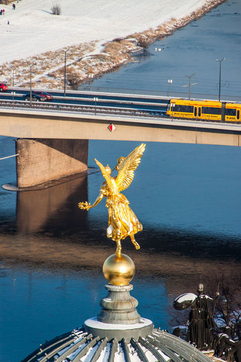 Statue of bridge over river