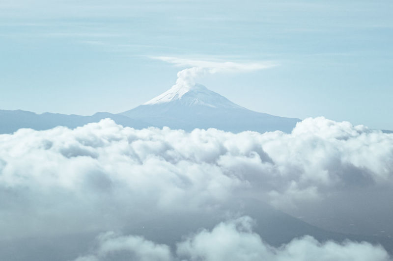 Above Aerial View Beauty In Nature Cloud - Sky Day Environment Erupting Eruption Idyllic Landscape Mountain Mountain Peak Nature No People Non-urban Scene Outdoors Scenics - Nature Sky Snow Snowcapped Mountain Summit Tranquil Scene Tranquility Volcanic Crater Volcano