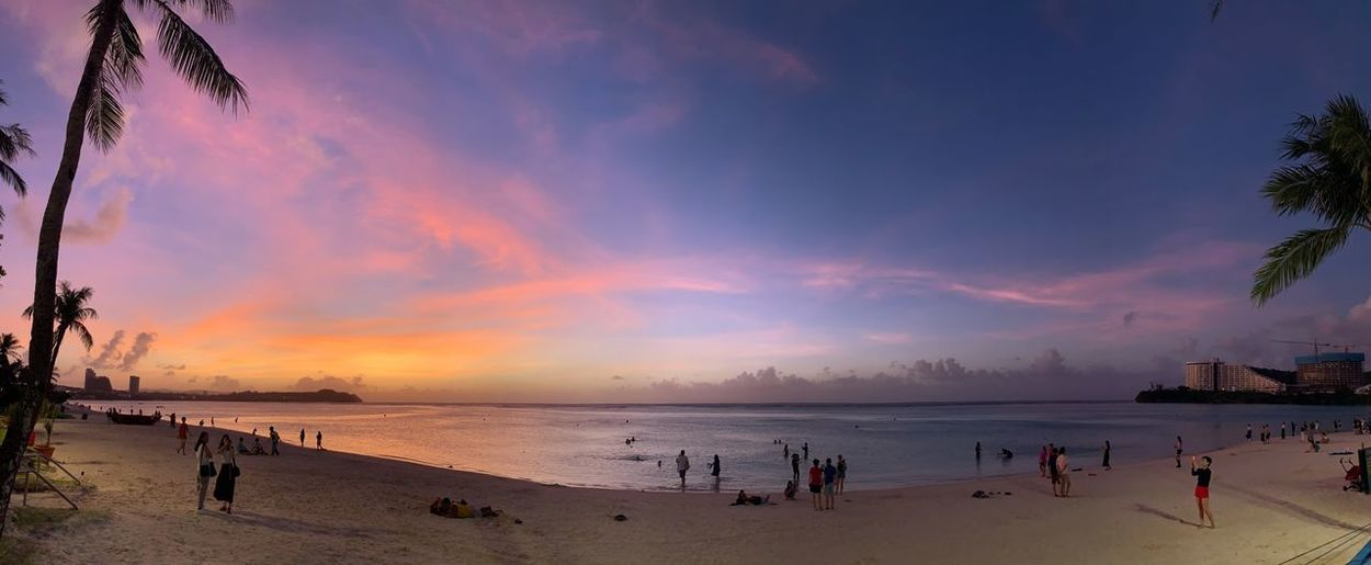 Sunset of TUMON beach Tumon Beach Guam Beach Water Sky Land Sea Sunset Beauty In Nature Scenics - Nature Cloud - Sky Large Group Of People Holiday Sand Nature Crowd Horizon Over Water Group Of People Outdoors Real People Vacations Horizon