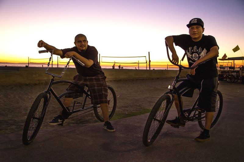 "Embrace Diversity Series: As we were leaving Huntington beach, after another amazing sunset, we came upon these fellas. I told them that they looked ""badass"" & asked if I could take their photo, just as they were on their low riders. They agreed & afterward I introduced myself & connected with one of them on Instagram. I'm stoked by the diversity of cultures, colors, & backgrounds in SoCal. Embrace diversity. Embrace Diversity Huntingtonbeach Huntington Beach Beach Beachphotography Beach Photography Streetphotography Street Photography Streetphoto_color Street Portrait Street Portraits Sunset Sunsets Sunset_collection Bike Bikers Low Rider  The Photojournalist - 2016 EyeEm Awards People Of The Oceans Original Experiences Two Is Better Than One CyclingUnites"
