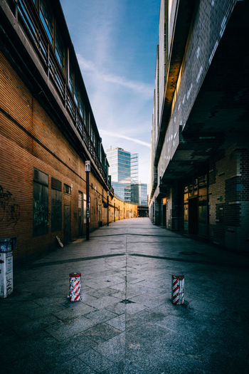 Urban hollow way Alleyway Architecture Bahnhof Zoo Building Exterior Built Structure City Day Façade Hollow Way Industry Narrow Narrow Street No People Outdoors Sky Train Station Urban Warehouse
