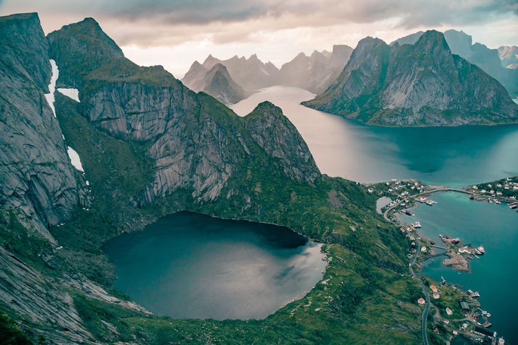Scenic view of lake and mountains against sky, lofoten, norway