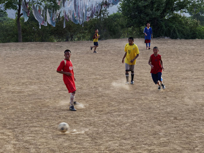 Monks playing soccer Boys Child Childhood Competition Day Full Length India Kicking Large Group Of People Leisure Activity Monks Outdoors People Real People Soccer Soccer Field Soccer Player Sports Clothing Sports Team Sportsman Togetherness