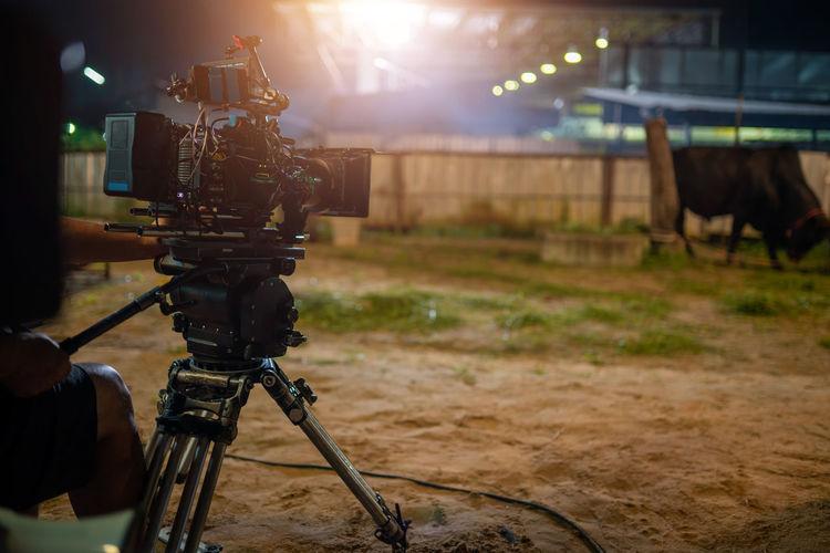 Close-up of illuminated camera on field