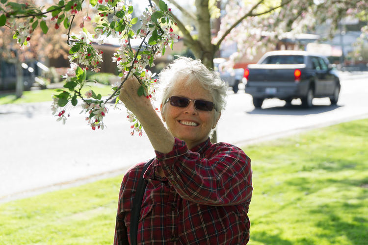 Senior citizen embracing spring Attractive Casual Clothing City Cute Day Focus On Foreground Fragility Freshness Front View Grey Hair Happiness Leisure Activity Lifestyle Lifestyles Looking At Camera Older Woman Person Portrait Smiling Spring Street