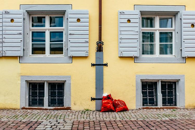 Garbage bags against buildings