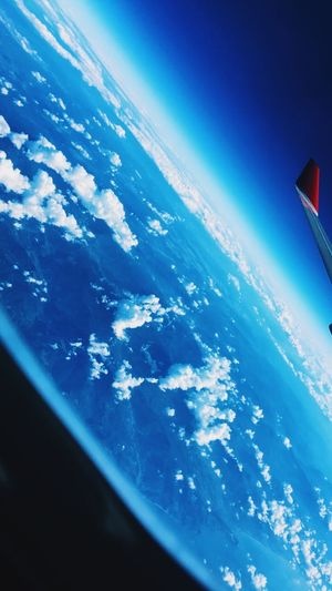 Blue Flying Nature Airplane Aerial View Cloud - Sky Mid-air Transportation Water Scenics Sea Planet Earth Day Mode Of Transport No People Sky Horizon Outdoors Air Vehicle