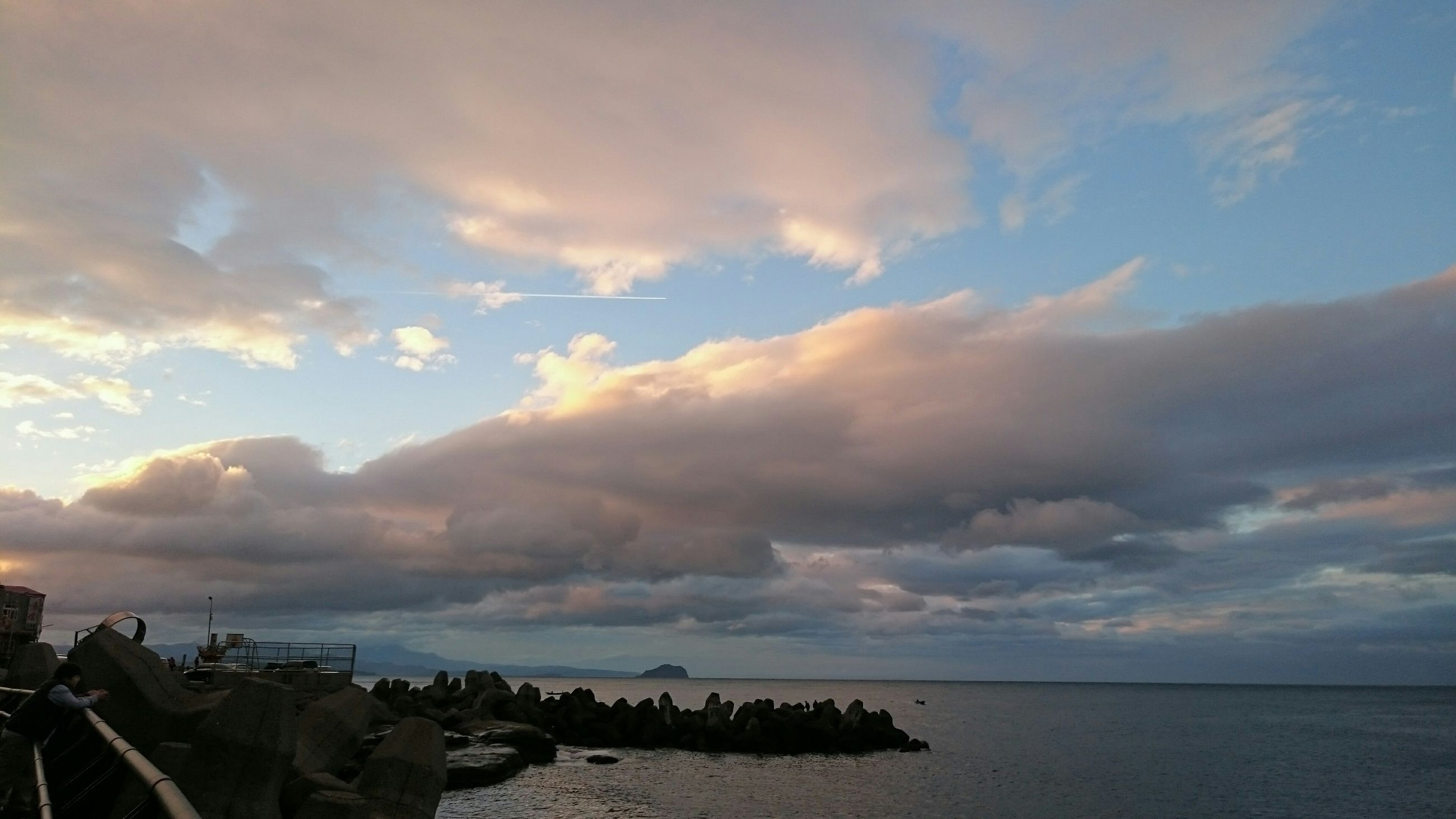 sea, water, sky, horizon over water, scenics, tranquil scene, tranquility, beauty in nature, cloud - sky, sunset, nature, cloudy, idyllic, cloud, waterfront, silhouette, outdoors, dusk, calm, no people