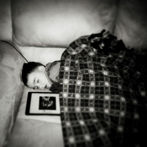 My tired nephew after Thanksgiving dinner. Passed out listening to music on the iPad lol Happythanksgiving Sleepyhead Lovethiskid Happyholidays