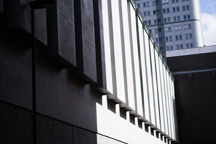 Enlightened Built Structure Architecture Pattern Office Building Exterior Wall - Building Feature Architectural Column Skyscraper Railing Low Angle View Building Exterior Building Modern Shadow Sunlight Office Window City Urban Monolith Plinth Column Columns And Pillars Capture Tomorrow Streetwise Photography The Art Of Street Photography The Architect - 2019 EyeEm Awards The Architect - 2019 EyeEm Awards