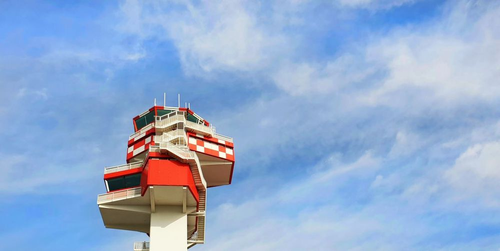 Low angle view of airport tower against sky
