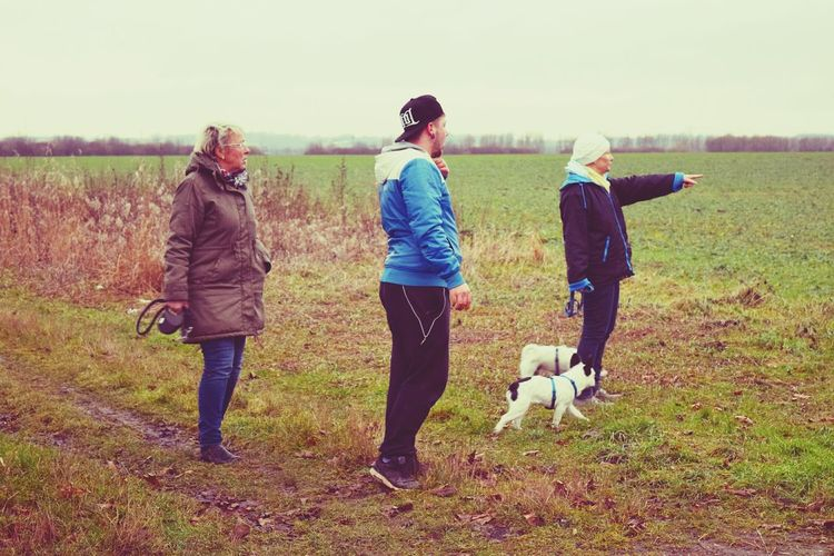 Friendship Rear View Outdoors People Green Color Grass Competition Togetherness Teamwork Dogslife Dogs Of Winter Dogs Of EyeEm Dogwalk The Places ı've Been Today Autumn 2016 December 2016 Fieldscape Showcase December From My Point Of View Animal Themes People Photography Young Adult