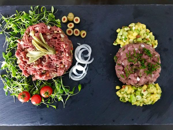 Delicious Tatar from beef and tuna with mango and avocado. Freshness Food Meat Vegetable Food And Drink No People Indoors  Variation Directly Above Ready-to-eat Healthy Eating Close-up Minced Day Minced Meat Tatar Beef Tuna Tunafish Mango Avocado