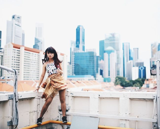 One against the world. Pastel Power Pastel EyeEm Best Edits EyeEm Best Shots Eye4photography  Urban Photography Urbex Urban Exploration Urban Singapore Adventure Portrait Of A Woman Portrait Photography Portrait Woman Women Of EyeEm Feminism Strong Woman Light