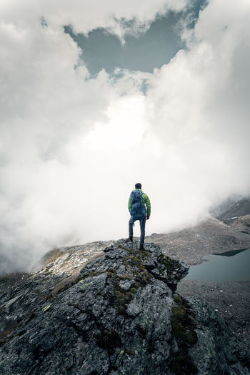 Enjoying the view. Standing Rear View One Person Mountain Rock Alps Hiking Backpack Backpacking Austria Leisure Activity Moody Sky Activity Nature Outdoors Looking At View Adventure Real People
