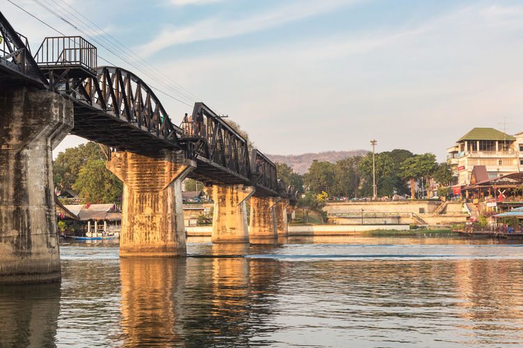 The famous River Kwai bridge in Kanchanaburi, Thailand. The bridge was part of the famous death railways that the Japanses tried to building between Burma and Thailand during WWII. Architecture Bridge Bridge - Man Made Structure Bridge Of River Kwai Building Exterior Built Structure Connection Day Kanchanaburi Kwai Landmark Nature No People Outdoors Railroad Track River Sky Thailand Transportation Water Waterfront