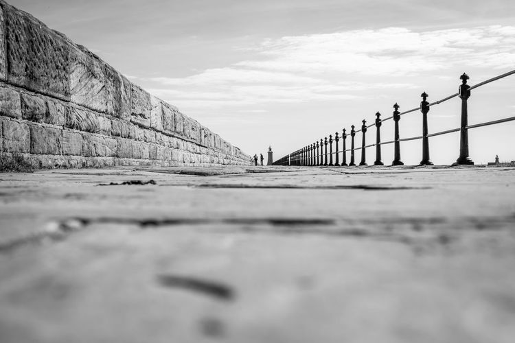 Tynemouth Piet EyeEm Gallery Photooftheday Blackandwhite Perspectives Perspective Nikon Northeast Nikonphotography Pier EyeEm Masterclass Sky Cloud - Sky Nature Day Built Structure Architecture Bridge Water Outdoors Surface Level Sea Tourism Travel Destinations Incidental People