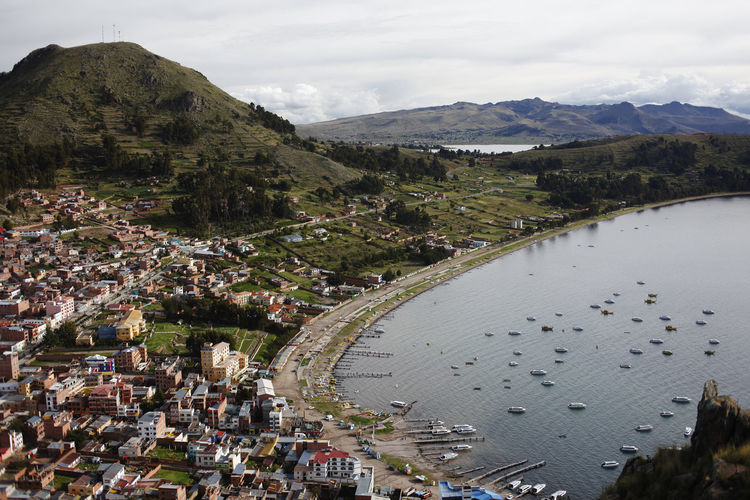isla del sol, bolivia Isla De Sol Bolivia TOWNSCAPE Outdoors Plant Residential District Mountain Range No People Landscape Building City Scenics - Nature Day Beauty In Nature Nature Sky Environment High Angle View Water Built Structure Building Exterior Architecture Mountain